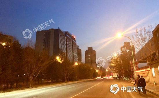 北京寒冷中迎小年山区有零星小雪 明起气温回升