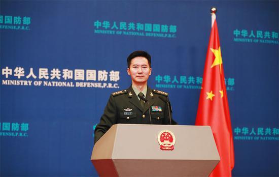 国防部新发言人谭克非亮相,大校军衔,曾就读于北京大学法学院图片