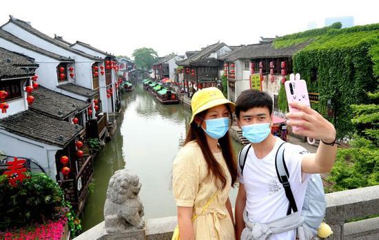 一部分景区受限逛吃住型城杏悦平台市被,杏悦平台图片