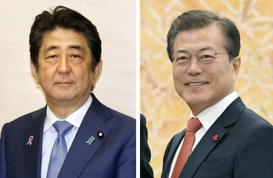东洋内阁总理安倍晋三(左)和韩国总统文在寅(右)(出处:东洋并肩社)