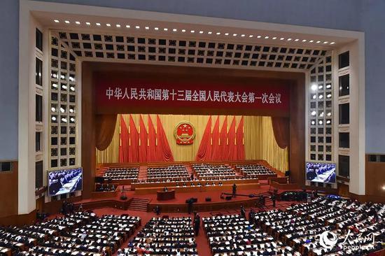 3月13日,十三届全国人大一次会议在人民大会堂举行第四次全体会议。人民网记者 翁奇羽 摄