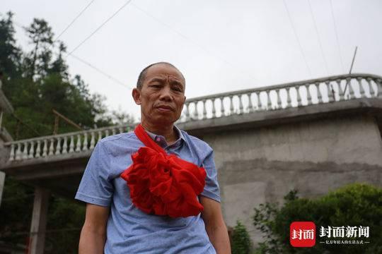 6月2日下午,李锦莲回到阔别20年的家乡江西省遂川县茂园村