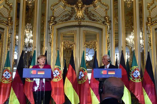 ▲5月31日,在葡萄牙访问的默克尔在新闻发布会上表示,美国对欧盟钢铝产品征收高关税违背世贸组织规则。 图/新华社