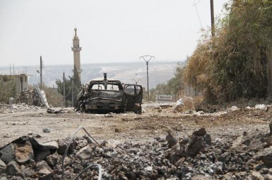 圖?交戰過後的一處敘利亞建築區