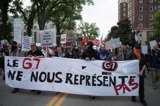 加拿大民众7日在魁北克抗议举行G7峰会(法新社)