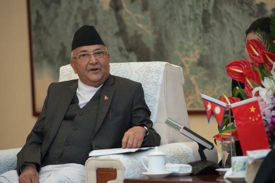 2018年6月20日,北京,在中国访问的尼泊尔总理卡<span class=