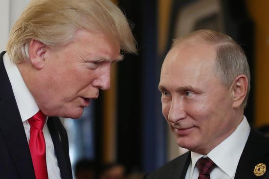 特朗普和普京。图自美媒