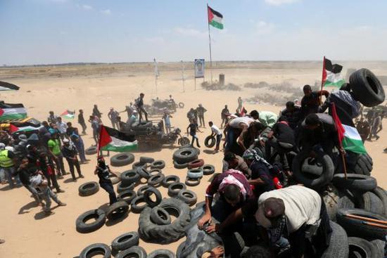 5月14日,巴以冲突致多名巴勒斯坦人丧生