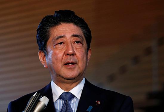 """当地时间2018年6月12日,日本东京,日本首相安倍晋三就""""特金会""""接受媒体采访。视觉中国 图"""