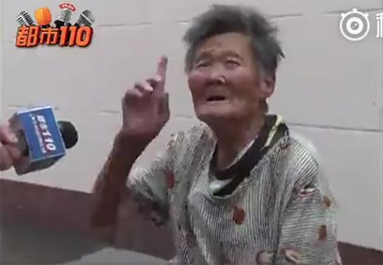 在太原火车站广场乞讨的老太 山西电视台《都市110》 图