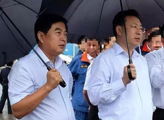 辛耀峰(左)与胡志强(右)
