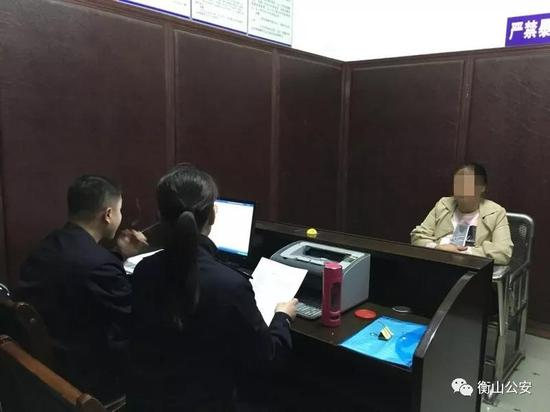 (外籍妇女玛盛欧正在接受民警的审讯)