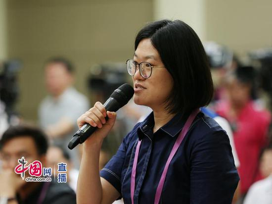 光明日报记者提问 中国网 宗超 摄