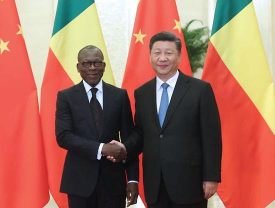 9月1日,国家主席习近平在北京人民大会堂会见贝宁总统塔隆。新华社