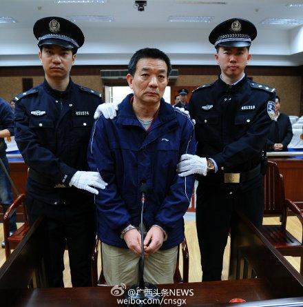 廖小波受审。材料图