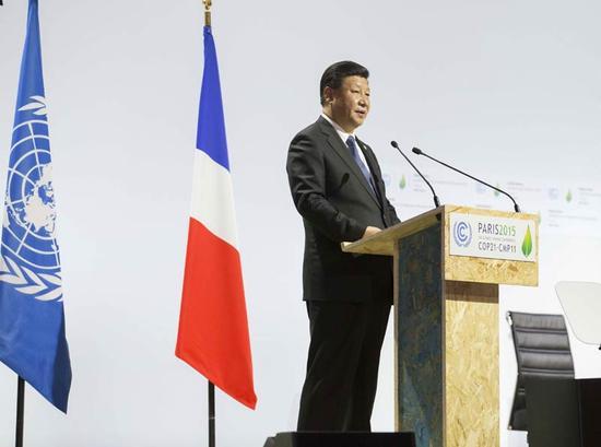图为:2015年11月30日,国度主席习近平在巴黎列席气象变迁巴黎大会揭幕式并揭晓题为《联袂构建协作双赢、公正合理的气象变迁管理机制》的紧张发言。