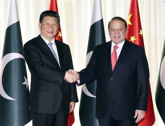 4月20日,国家主席习近平在伊斯兰堡同巴基斯坦总理谢里夫举行会谈。新华社记者 兰红光 摄