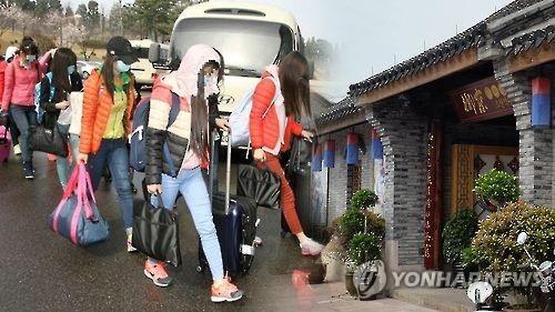 今年4月投奔韩国的朝鲜餐厅员工。(图片来自韩联社)