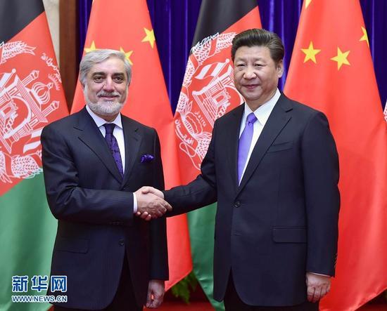 习近平会见阿富汗首席执行官