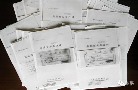 李某某以两个儿子名义购买的41套房屋买房合同