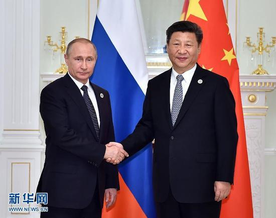 6月23日,国度主席习近平在乌兹别克斯坦塔什干会面俄罗斯总统普京。新华社记者李涛摄