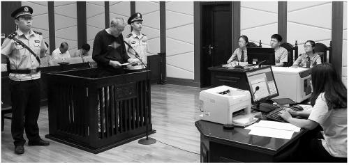 图为庭审现场。齐民摄