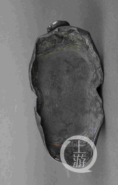 彭山江口出土的银锭。