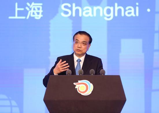 ���赵嚎�理李克��21日上午在上海���H���h中心出席第九�萌�球健康促�M大���_幕式并致�o。