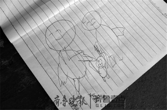 在遗书的后一页,张富画了一个三口之家的简笔划。