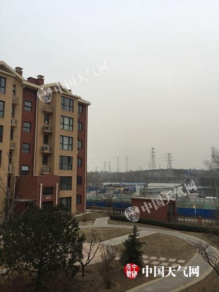 今晨,北京天空阴沉,一场降雪正在酝酿。