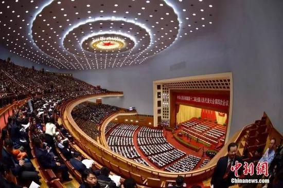 资料图:2016年3月5日,十二届全国人民代表大会四次会议在人民大会堂举行开幕会。中新社记者 金硕 摄