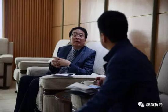 程国平接受记者采访