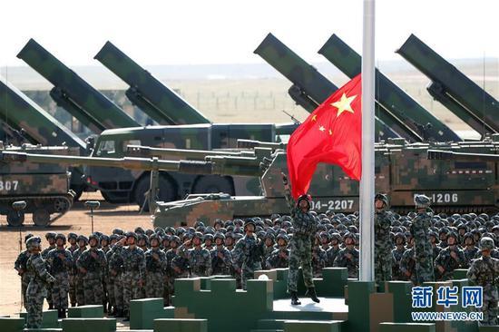 这是升旗仪式。新华社记者 庞兴雷 摄