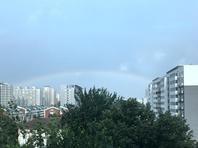北京雷雨快闪而过 海淀双彩虹炫亮天际