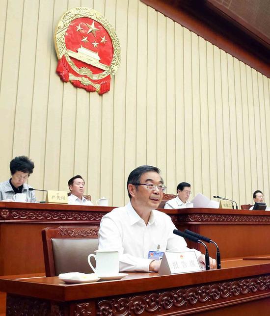 8月29日,最高人民法院院长周强在第十二届全国人民代表大会常务委员会第二十九次会议上。   全国人大网 李杰 摄