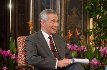 """李显龙:在中国出门""""不怕口袋没钱 只怕手机没电"""""""