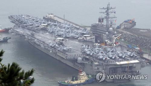 """资料图片:""""里根""""号核动力航空母舰(图片泉源:韩联社)"""