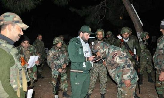资料图:在叙利亚参战的民兵武装,伊朗军事顾问协助指挥。