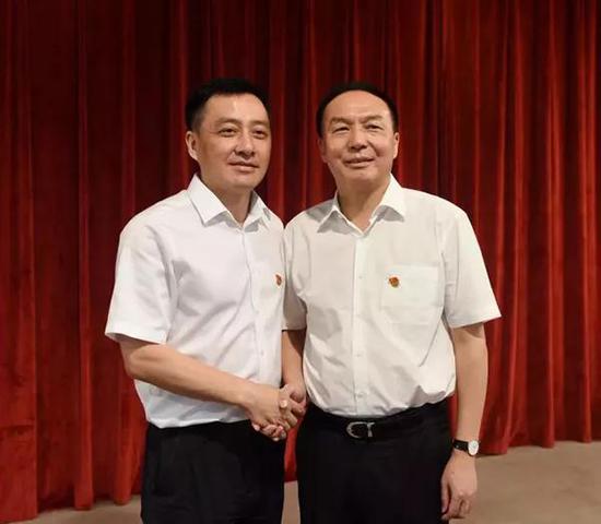 刘洪建(左)、许维泽(右)