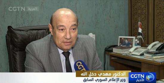 △叙利亚前新闻部长马赫迪•达赫拉拉经受CGTN阿语频道记者采访
