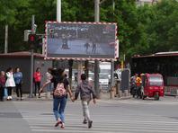 闯红灯上大屏幕 北京街头设行人闯红灯曝光屏幕