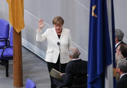 2018年3月14日,在德国首都柏林,默克尔宣誓就职。新华社记者 单宇琦 摄
