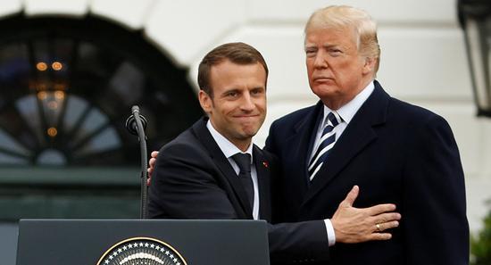 图为4月24日特朗普在白宫欢迎马克龙。(路透社)