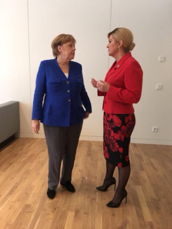 克罗地亚女总统科琳达与默克尔交谈