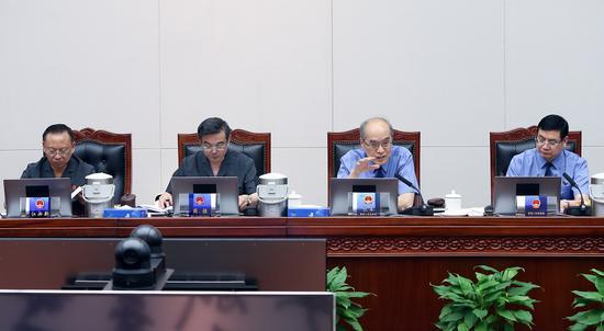 6月11日,最高人民检察院检察长、首席大检察官张军首次列席最高人民法院审判委员会。孙若丰 摄