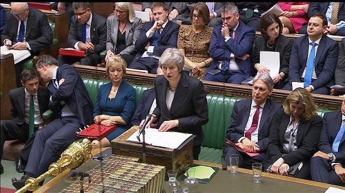 特雷莎·梅15日在英國下議院發表關於脫歐協議草案講話的視頻截圖(路透社)