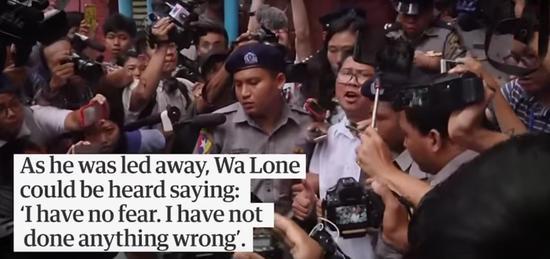 《卫报》视频截图:瓦隆走出法庭后发表讲话。