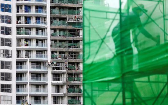 ▲当地时间2018年8月,柬埔寨金边一建筑工地。 图片来源:视觉中国
