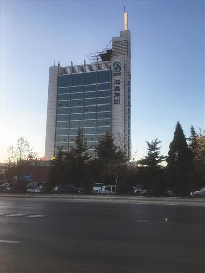 建龙办公楼,原有的海鑫大厦未更名。新京报记者 彭彬 摄
