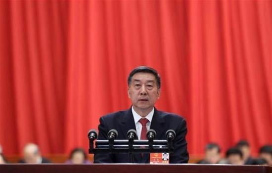 国务委员王勇向十三届全国人大一次会议作关于国务院机构改革方案的说明。新华网 图